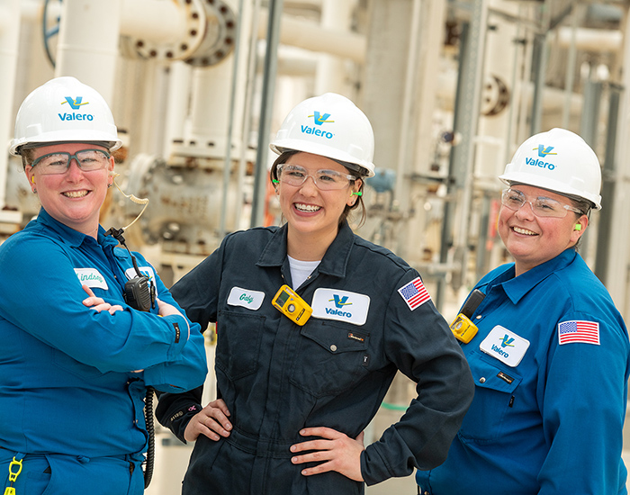 Three female refinery employees