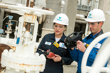 Valero employees using leak detection and repair equipment