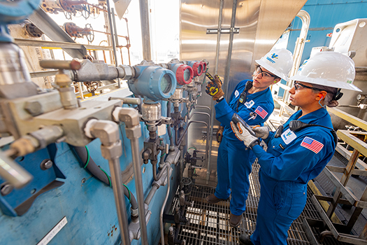 Valero refinery employees performing safety check