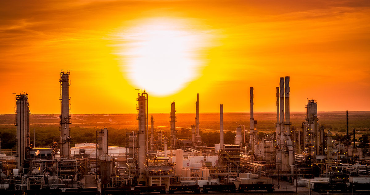 Refinery landscape silhouette image at sunset