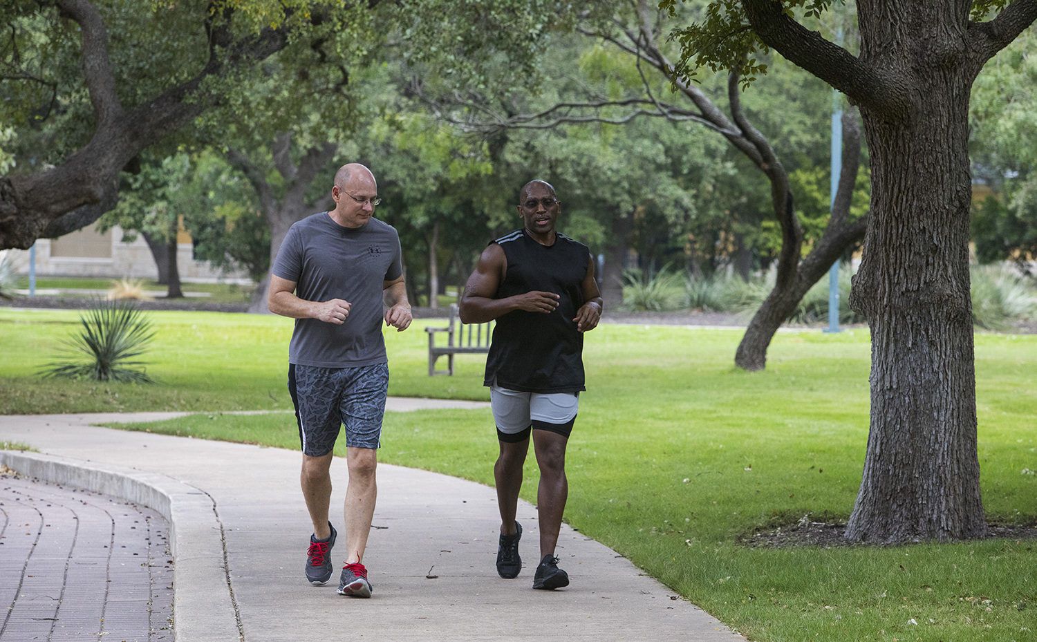 Two Valero employees jogging on a path
