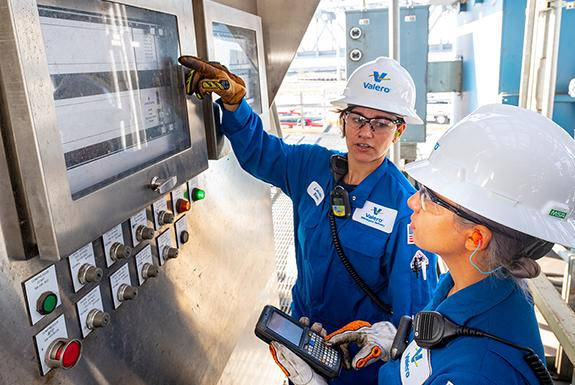Two female Valero refinery employees