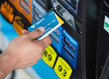 Customer with Valero card at gas pump