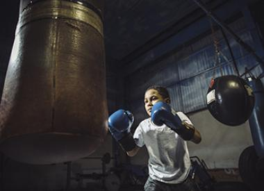 Young boy practicing boxing skillls