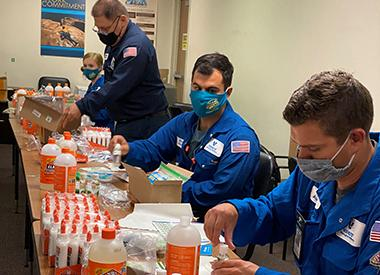 Valero volunteers prepare slime kits for students